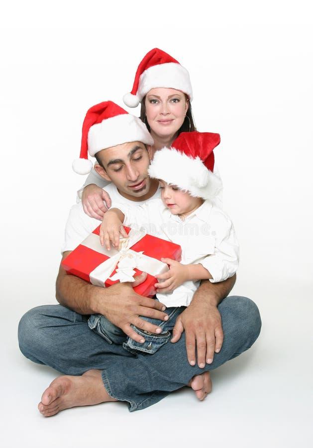 De samenhorigheid van de familie bij Kerstmis stock fotografie