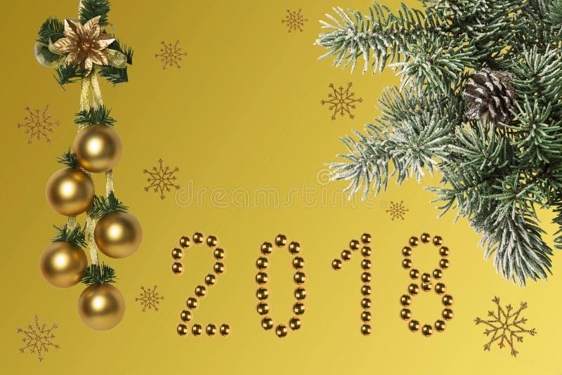 De samenstelling van de Kerstmisvakantie op gouden die achtergrond met met een tak van sparren met sneeuw worden behandeld royalty-vrije stock fotografie