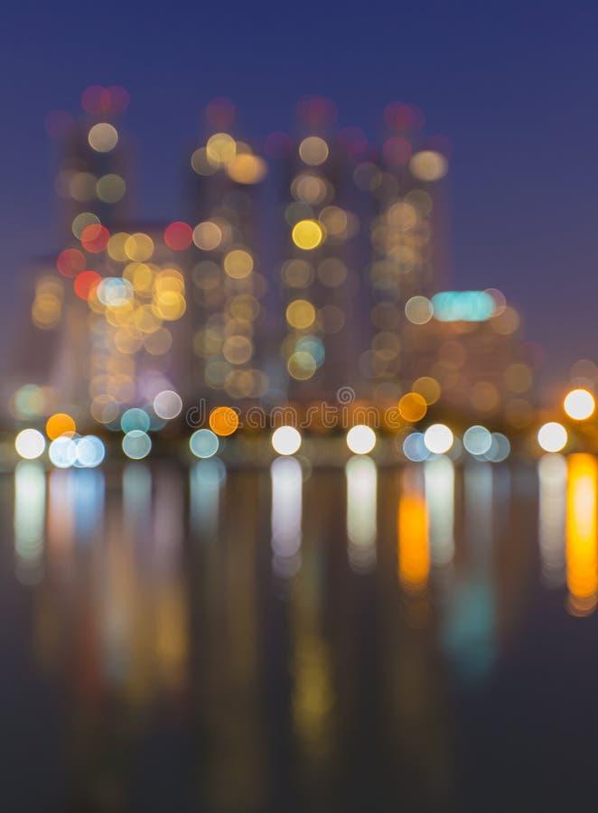 De samenvatting, nachtcityscape licht onduidelijk beeld bokeh, defocused achtergrond stock fotografie