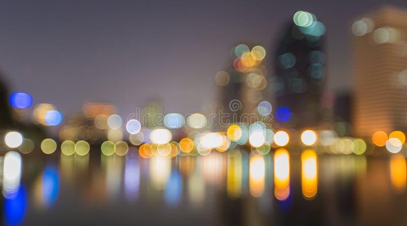 De samenvatting, nachtcityscape licht onduidelijk beeld bokeh, defocused achtergrond stock afbeelding