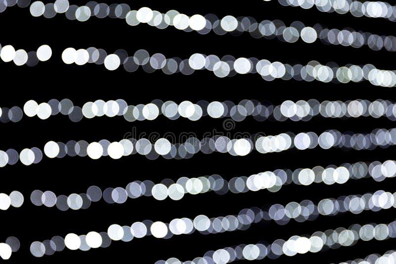 De samenvatting schittert fonkeling bokeh defocused op zwarte achtergrond velen rond licht op achtergrond stock fotografie