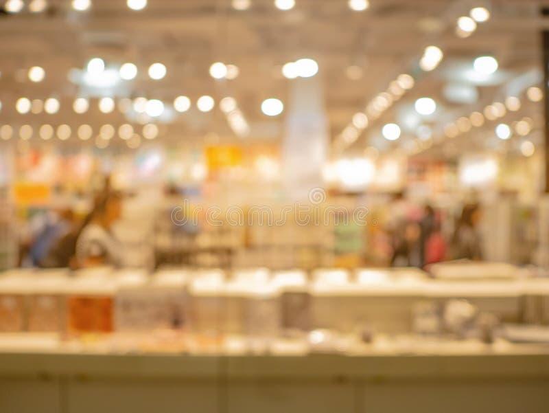 De samenvatting vertroebelde en defocused van het winkelen warenhuis, stock fotografie