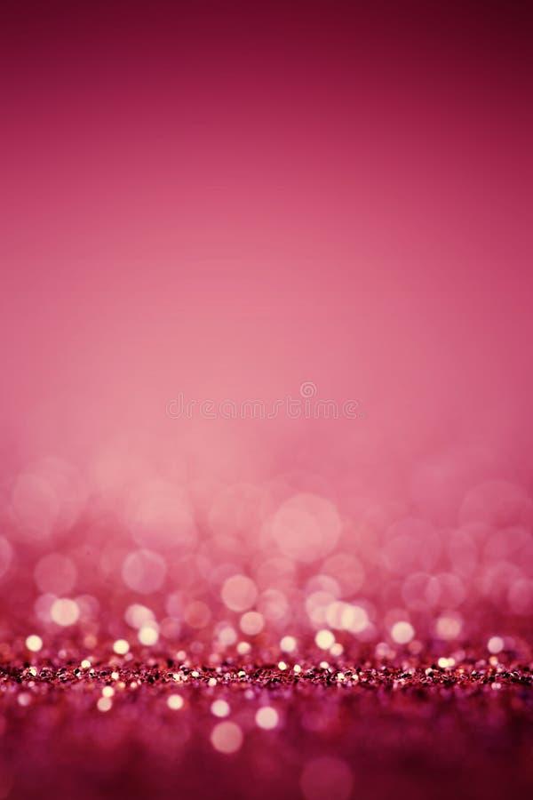 De samenvatting vertroebelde roze achtergrond met schittert fonkeling bokeh royalty-vrije stock afbeelding