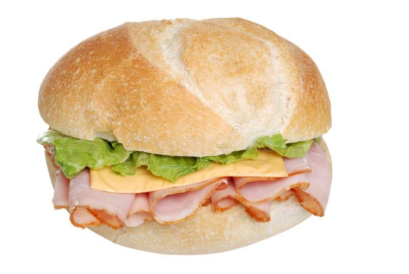 De sandwich van de ham en van de kaas op een geïsoleerdd broodje royalty-vrije stock afbeelding