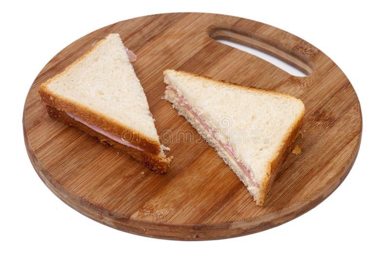 De sandwiches van de driehoekstoost met ham stock afbeelding