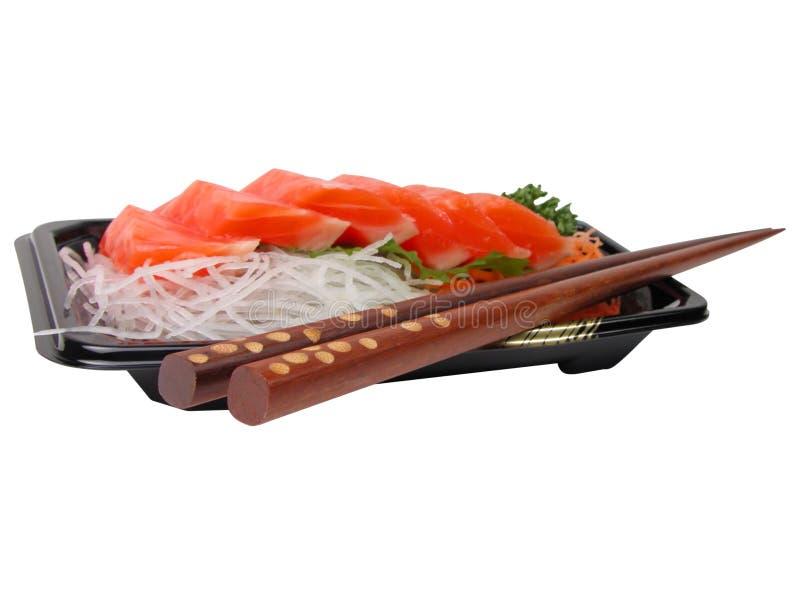 De sashimi en de eetstokjes van de zalm stock afbeeldingen