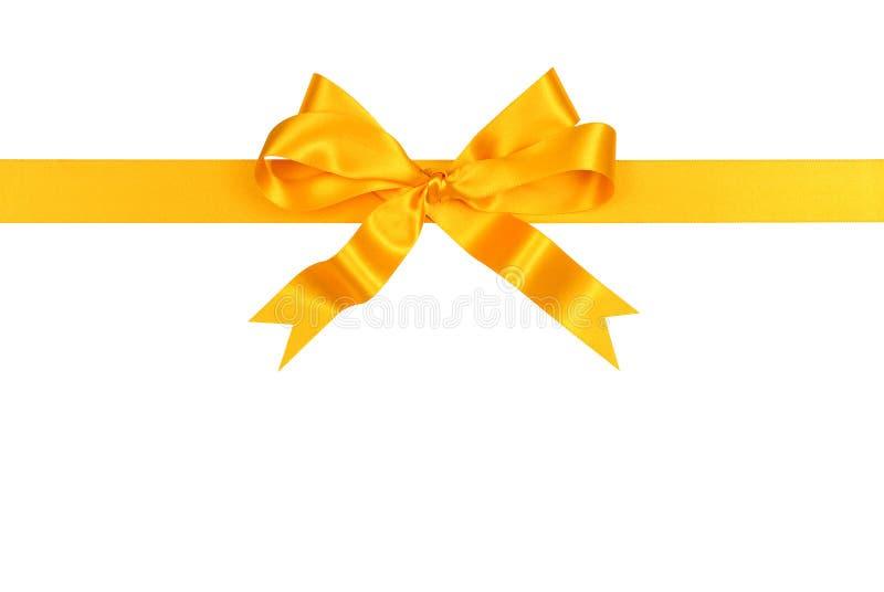 De satin de ruban d'arc horizontal jaune directement d'isolement sur le fond blanc image libre de droits