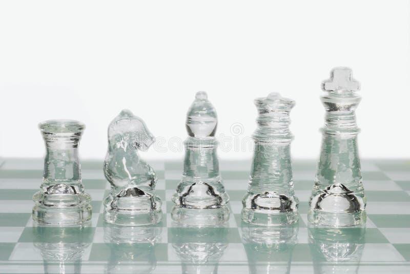 De schaakstukken van het glas royalty-vrije stock afbeelding