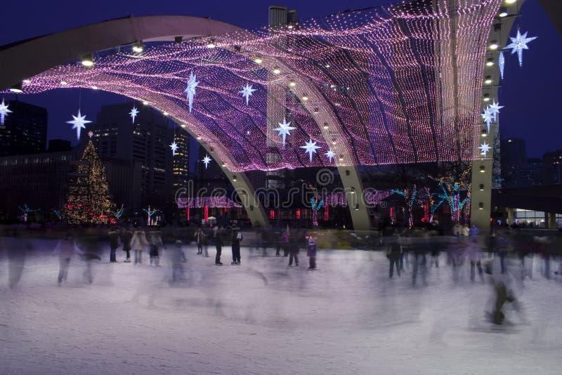 De schaatsers van Kerstmis stock foto's