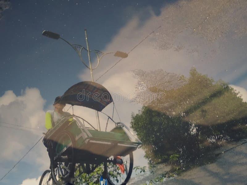 De Schaduw van een Pedicab-Bestuurder royalty-vrije stock afbeelding