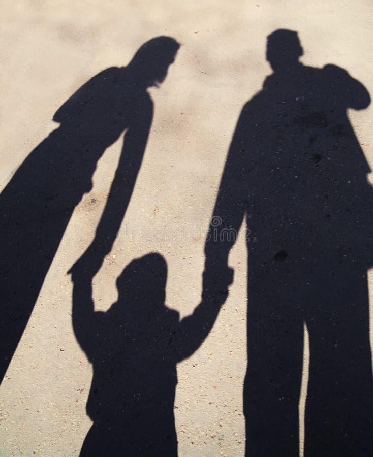 De schaduwsilhouet van de familie stock fotografie
