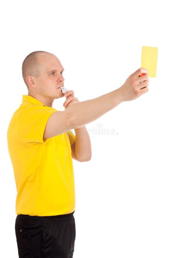 De scheidsrechter die van de voetbal u de gele kaart tonen stock foto's
