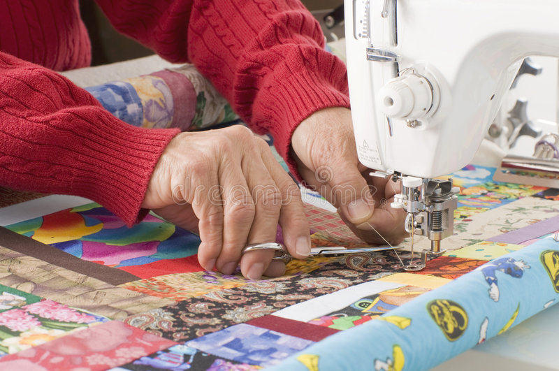 De scherpe draad van Quilter op naaimachine. stock fotografie