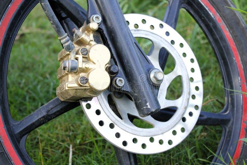 De schijfrem van het motorfietswiel stock afbeelding