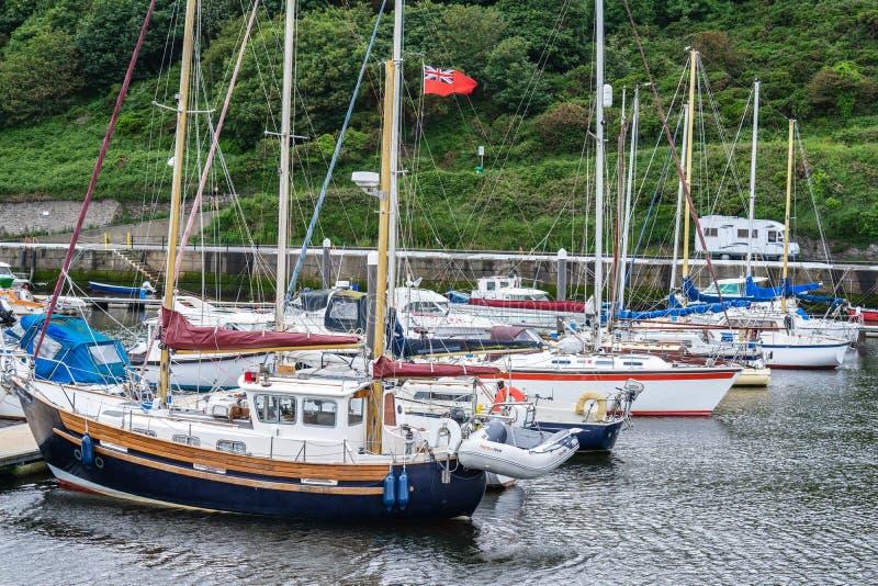 De schil is een kuststad en een kleine vissershaven op het Eiland Man, in de historische parochie van het Duits maar afzonderlijk stock fotografie