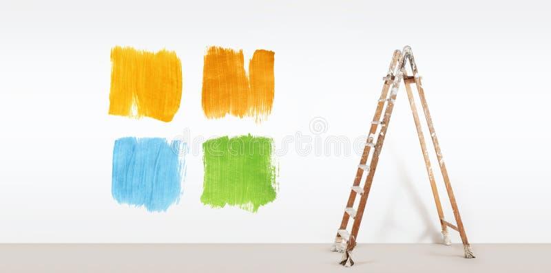 De schildersladder met verf kleurt steekproeven, die op muur worden geïsoleerd stock foto's