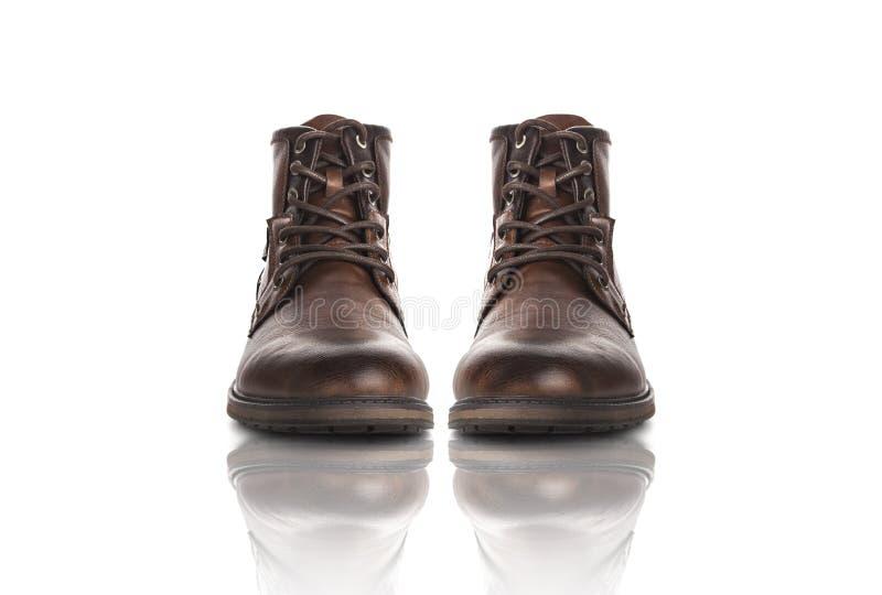 De schoenen bruine toevallig van mensen Geïsoleerdj op witte achtergrond royalty-vrije stock foto
