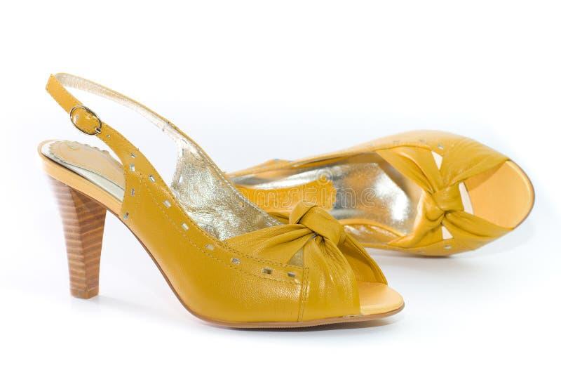 De schoenen van de gele dame. stock foto's