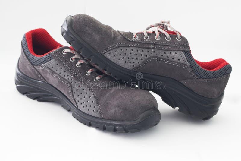 De schoenen van de veiligheid stock foto's