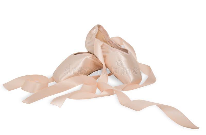 De schoenen van het ballet op een witte achtergrond stock afbeelding
