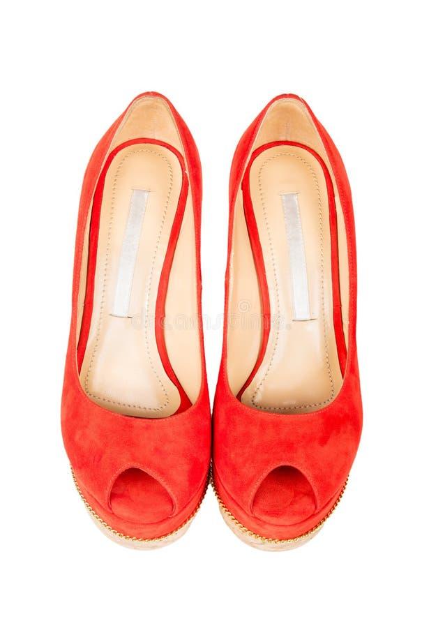 De schoenen van rode vrouwen royalty-vrije stock foto's