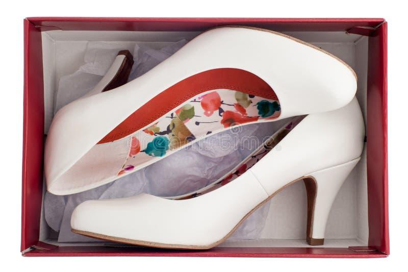 De schoenen van vrouwen op hoge geïsoleerdew hielen stock foto's