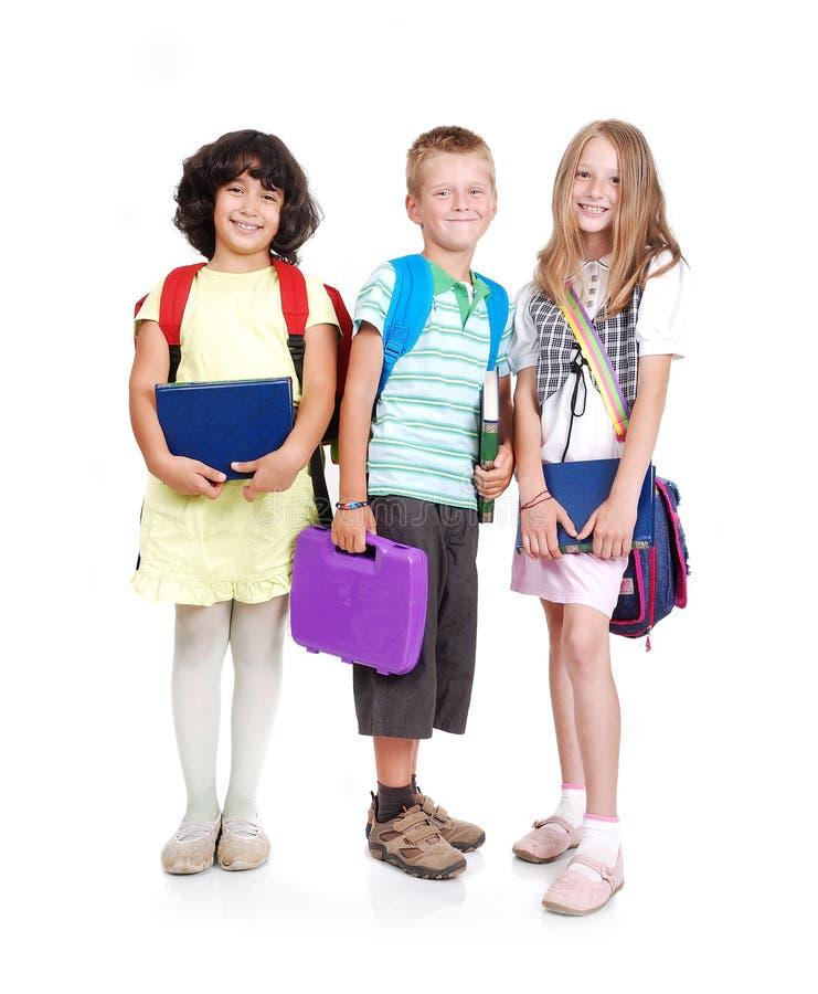 De schoolkinderen van het trio stock foto