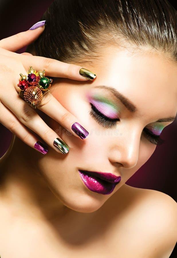 De Schoonheid van de manier. Manicure en Make-up stock afbeeldingen