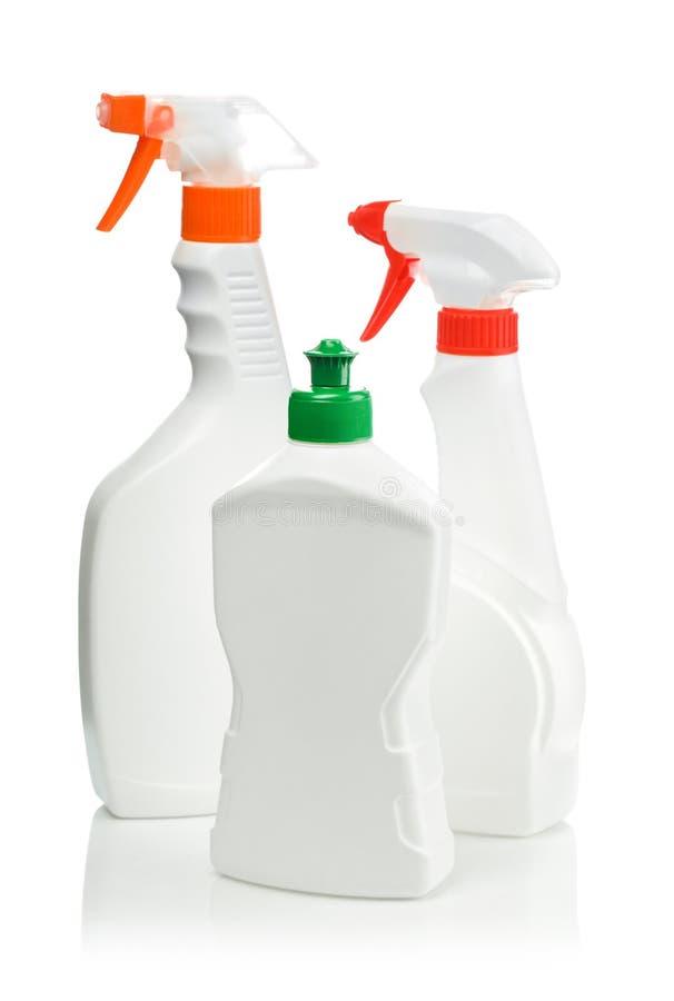 De schoonmakende flessen van de nevel stock afbeelding