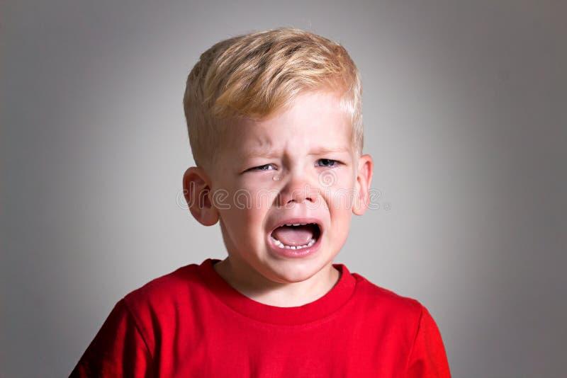 De schreeuwende jongen van het jong geitjekind royalty-vrije stock afbeelding