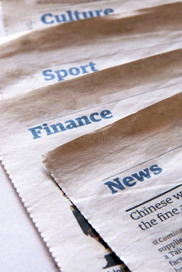 De secties van de krant stock foto's