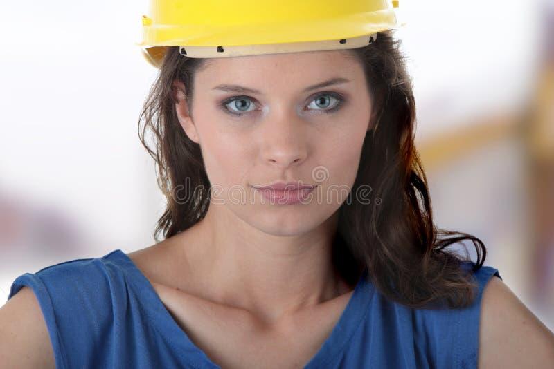 De sexy jonge contractant van de vrouwenbouwvakker stock foto