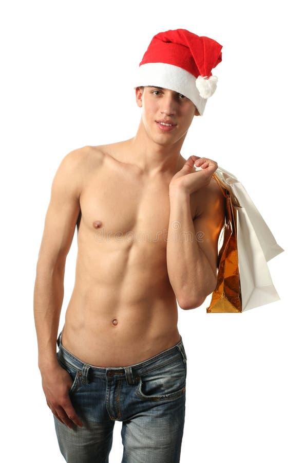 De sexy Kerstman met het Winkelen Zakken royalty-vrije stock afbeeldingen