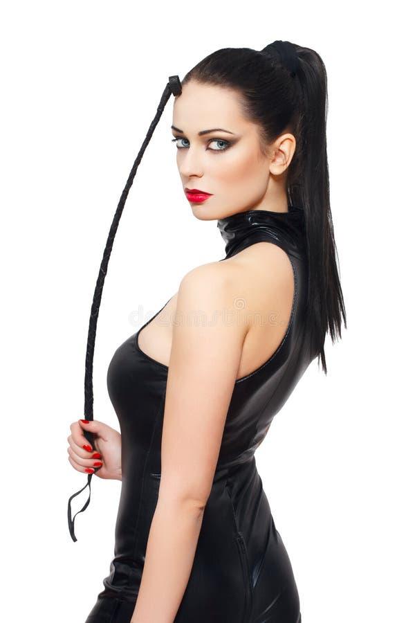 De sexy vrouw in latex catsuit en ranselt stock afbeeldingen