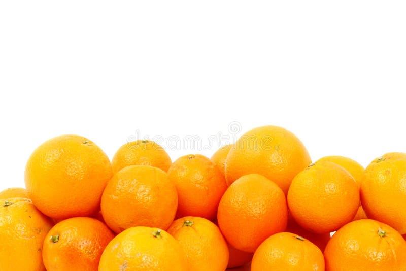 De sinaasappelen isoleerden velen royalty-vrije stock foto
