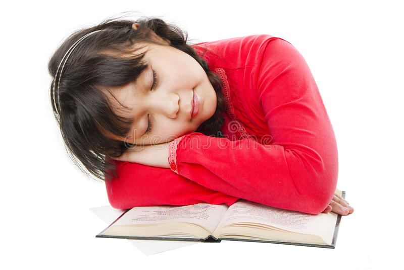 De slaap van het meisje op een boek royalty-vrije stock fotografie