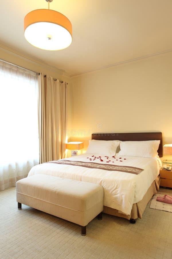De slaapkamer van het hotel stock fotografie