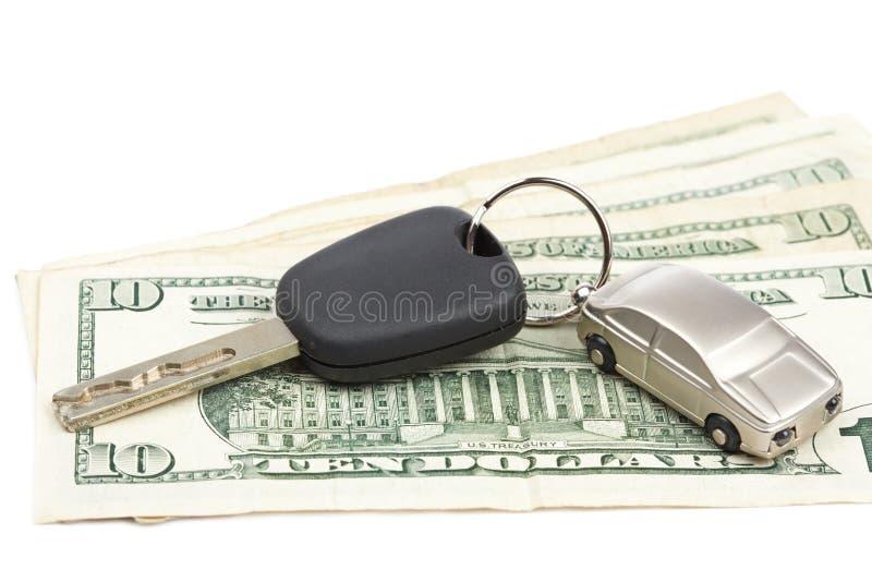De sleutel en het geld van de auto stock fotografie