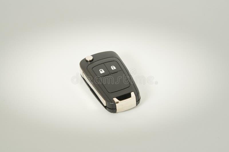 De sleutel van de auto op een witte achtergrond Perfect symbool om een voertuig te verwerven, bezit enz. te hebben stock foto