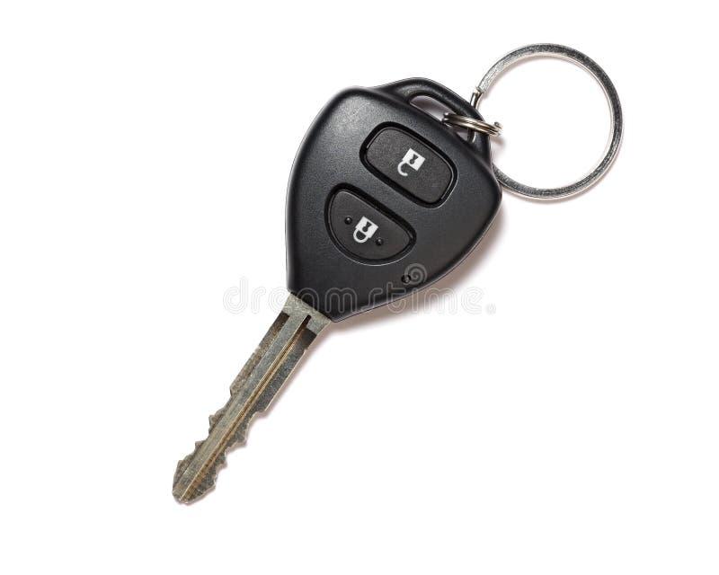 De sleutel van de auto die op witte achtergrond met schaduw wordt geïsoleerd stock foto's