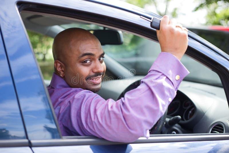 De sleutel van de bestuurdersholding stock afbeelding