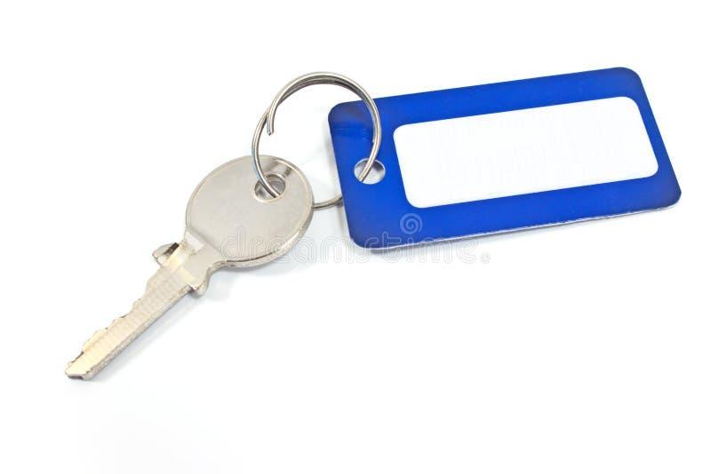 De sleutel van het huis met blauwe markering stock afbeeldingen