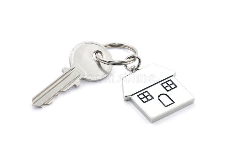 De sleutel van het huis met het knippen van weg stock afbeeldingen