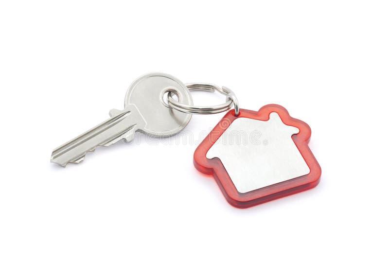 De sleutel van het huis met het knippen van weg stock fotografie