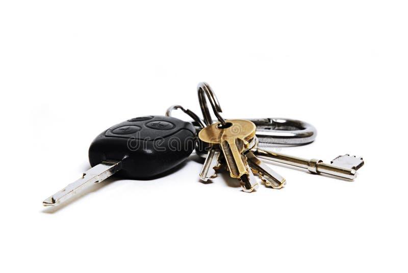 De sleutels van de auto en van het huis stock foto
