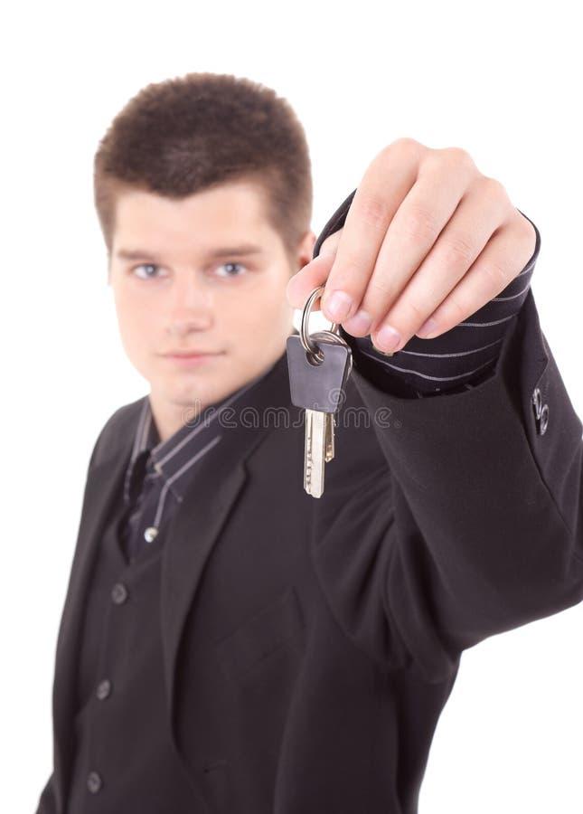 De sleutels van de jonge mensenholding royalty-vrije stock afbeelding