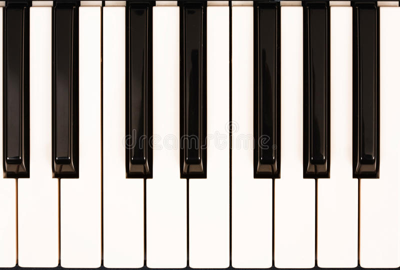 De sleutels van de piano stock afbeeldingen
