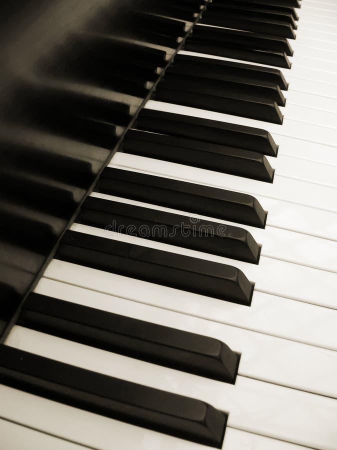 De sleutels van de piano in sepia royalty-vrije stock afbeeldingen