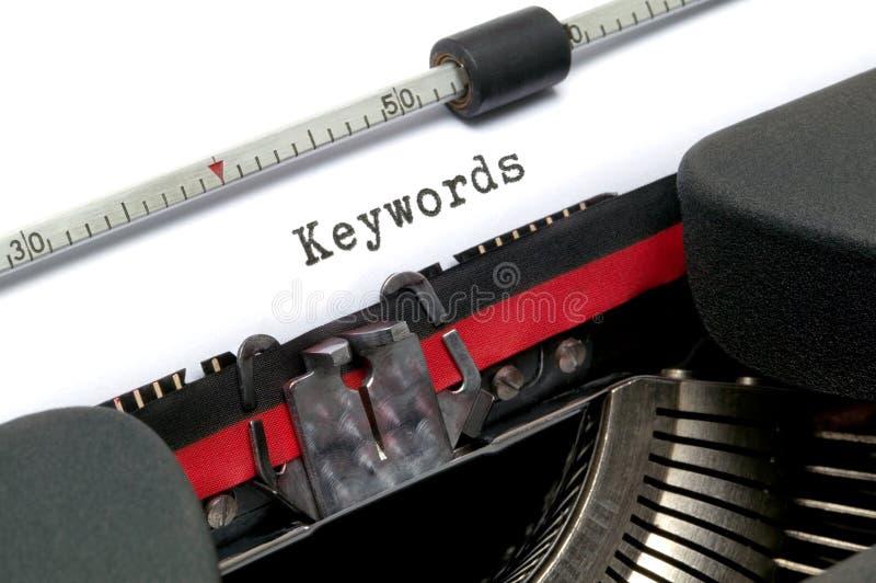 De Sleutelwoorden van de schrijfmachine stock afbeelding