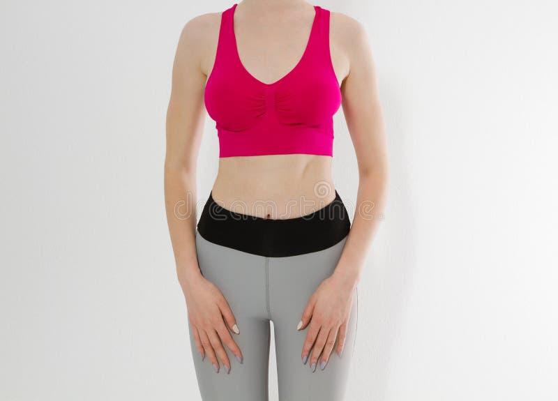 De slijtage van de vrouwensport en cijfer van het meisjes het sportieve die lichaam op witte achtergrond wordt geïsoleerd Sporten stock afbeeldingen